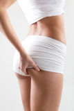 Attractive woman with perfect body checking cellulite on her buttocks Royalty Free Stock Image