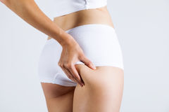 Attractive woman with perfect body checking cellulite. Royalty Free Stock Photo