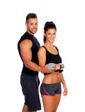 Attractive woman and a personal trainer Royalty Free Stock Photography