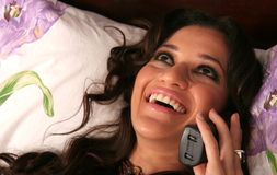 Attractive woman on the phone. Young beautiful woman enjoying a phone conversation Stock Images