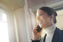 Attractive woman on the phone next to a window Stock Image