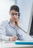 Attractive woman on the phone Royalty Free Stock Photography