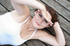 Attractive woman on a pier Stock Images