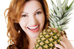 Attractive woman with pineapple. Royalty Free Stock Photography