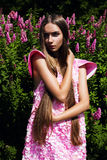 Attractive woman in pink dress Royalty Free Stock Images