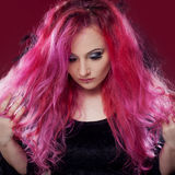 Attractive woman with pink hair in witch image. Halloween style Royalty Free Stock Image