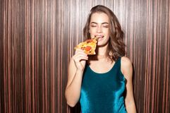 Attractive woman with pizza piece stock photos