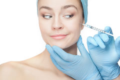 Attractive woman at plastic surgery with syringe in her face Royalty Free Stock Photography
