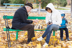 Attractive woman playing chess with her father Stock Image