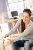Attractive woman playing computer game at home Stock Photo
