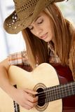 Attractive woman playing guitar with joy Royalty Free Stock Photo