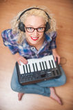 Attractive woman playing music keyboard Stock Photography