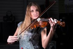 Attractive woman plays on violin Stock Photo
