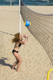 Attractive woman plays in volleyball Royalty Free Stock Image