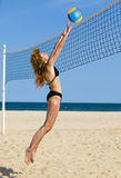 Attractive woman plays in volleyball Royalty Free Stock Photography