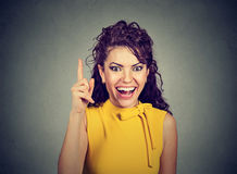 Attractive woman pointing finger up has an idea Stock Image