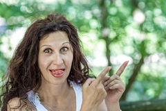 Attractive woman pointing fingers Royalty Free Stock Photography