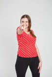Attractive woman pointing Stock Image