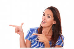 Attractive woman pointing to her right Stock Image