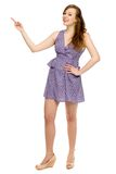 Attractive woman pointing up Royalty Free Stock Image