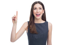 Attractive woman pointing up Stock Images
