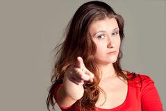 Attractive woman pointing at viewer Stock Photo