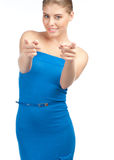 Attractive woman pointing at viewer Royalty Free Stock Photography