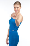 Attractive woman pointing at viewer Stock Image