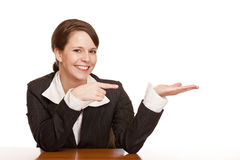 Attractive woman points with finger on ad space Royalty Free Stock Photos