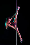 Attractive woman pole dancer performing Royalty Free Stock Photography