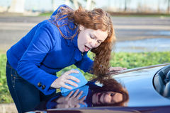 Attractive woman polishing car Royalty Free Stock Photos