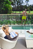 Attractive woman and pool boy Royalty Free Stock Photography