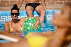 Attractive woman in pool at summer Stock Photos