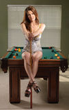 Attractive woman on pool table Stock Image