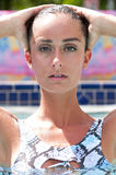 Attractive woman in a pool wearing a swimsuit. Royalty Free Stock Images
