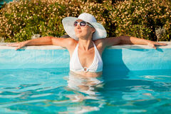 Attractive woman in the pool Royalty Free Stock Image