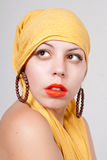 Attractive woman portrait. Young attractive woman portrait with yellow scarf Royalty Free Stock Photos