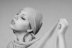 Attractive woman portrait. Young attractive woman portrait with scarf Royalty Free Stock Images