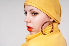 Attractive woman portrait. Young attractive woman portrait with yellow scarf Stock Photos