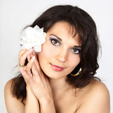Attractive woman portrait with white flower Stock Image