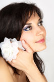 Attractive woman portrait with white flower Stock Images