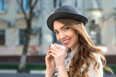 Attractive woman poses with white cup. Royalty Free Stock Photo