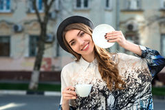Attractive woman poses with white cup. Royalty Free Stock Photography