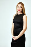 Attractive woman posing in black official dress Royalty Free Stock Image