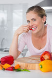 Attractive woman posing while eating vegetables Stock Image