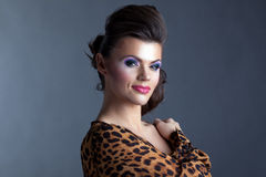 Attractive woman posing with evening make-up Royalty Free Stock Photography