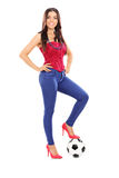 Attractive woman posing with a football Royalty Free Stock Photo