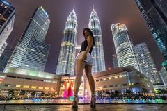 Asian woman and modern buildings Stock Photography