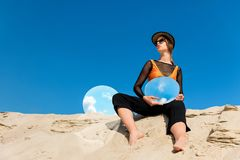Attractive woman posing with round mirrors with reflection of. Blue sky royalty free stock images