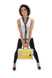 Attractive woman posing with toolbox over white. Attractive woman posing with golden toolbox over white Royalty Free Stock Photos